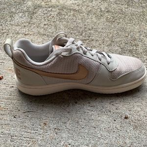grey and gold nike shoes